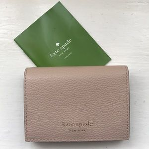 NEW Kate Spade flap card holder in beige leather